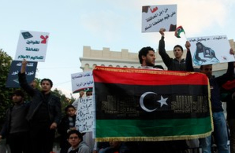 Libyan Muslims rally in support of sharia law 311 (R) (photo credit: REUTERS/Ismail Zitouny)