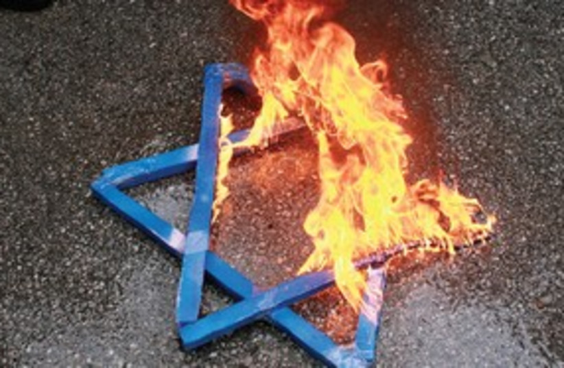 Burning Jewish star anti semitism magen david 311 (photo credit: Umit Bektas/Reuters)