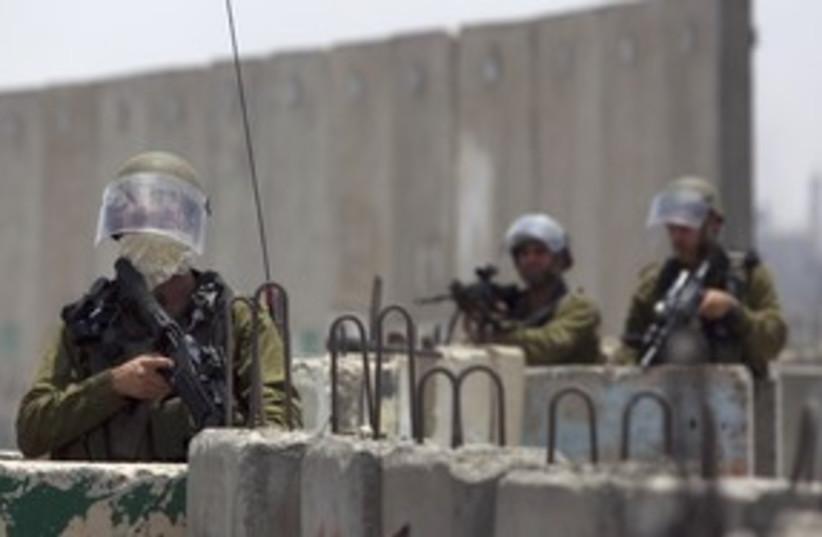 Soldiers at the Kalandiya checkpoint 311 (R) (photo credit: REUTERS/Darren Whiteside)