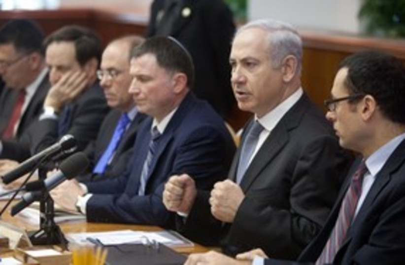 Prime Minister Binyamin Netanyahu pounding fists 311 (photo credit: Emil Salman / Pool / Haaretz)