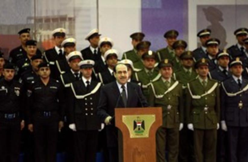 Iraqi Prime Minister Nuri al-Maliki 311 (R) (photo credit: REUTERS/Thaier al-Sudani)