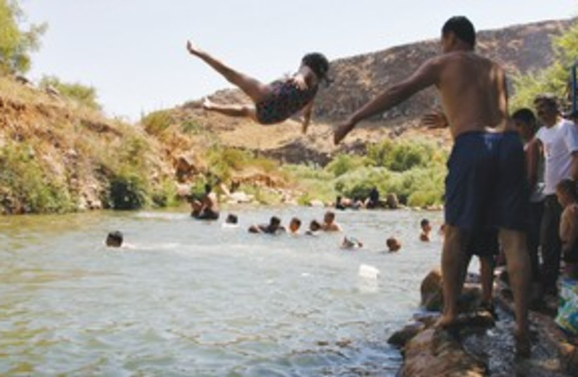 Lebanese villagers play in water 311 (photo credit: REUTERS)