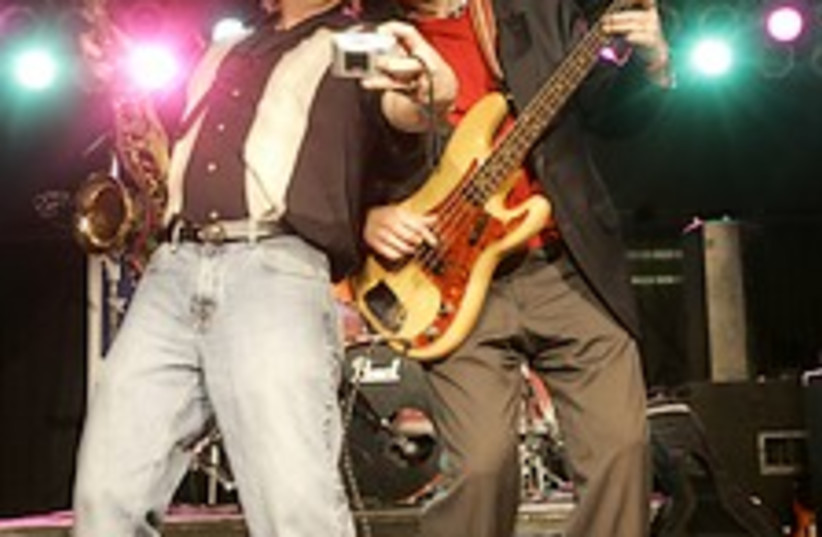 Huckabee guitar 224.88 (photo credit: AP)