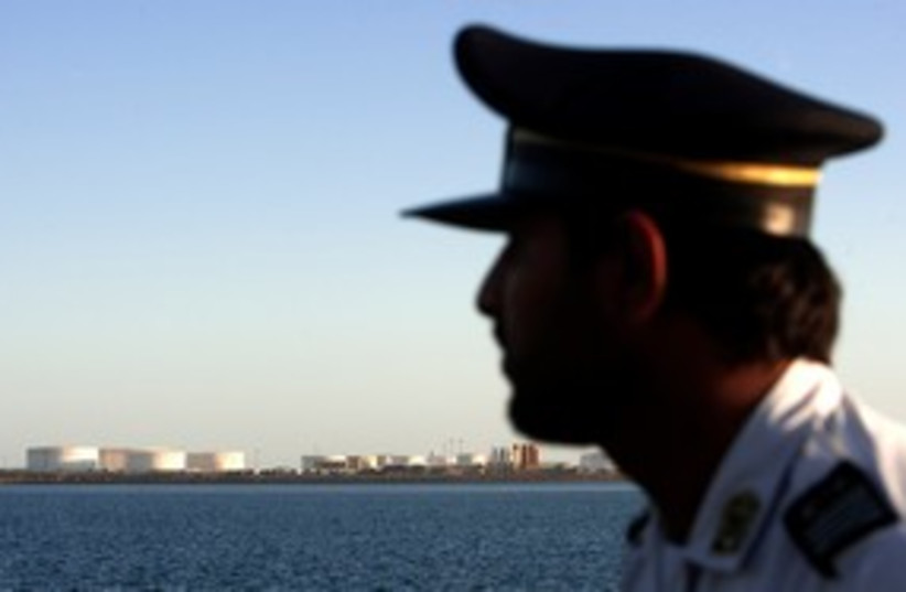 Iranian officer looks at Strait of Hormuz 311 (R) (photo credit: REUTERS/Raheb Homavandi)