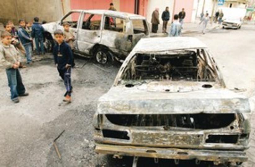 Palestinians near damaged cars 311 (photo credit: REUTERS)