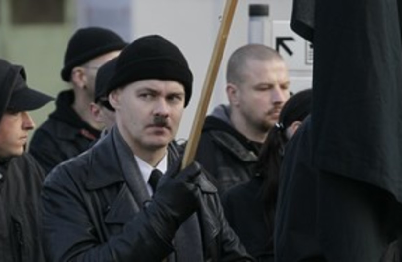 A German neo-Nazi at a rally in Remagen 311 (R) (photo credit: Wolfgang Rattay / Reuters)