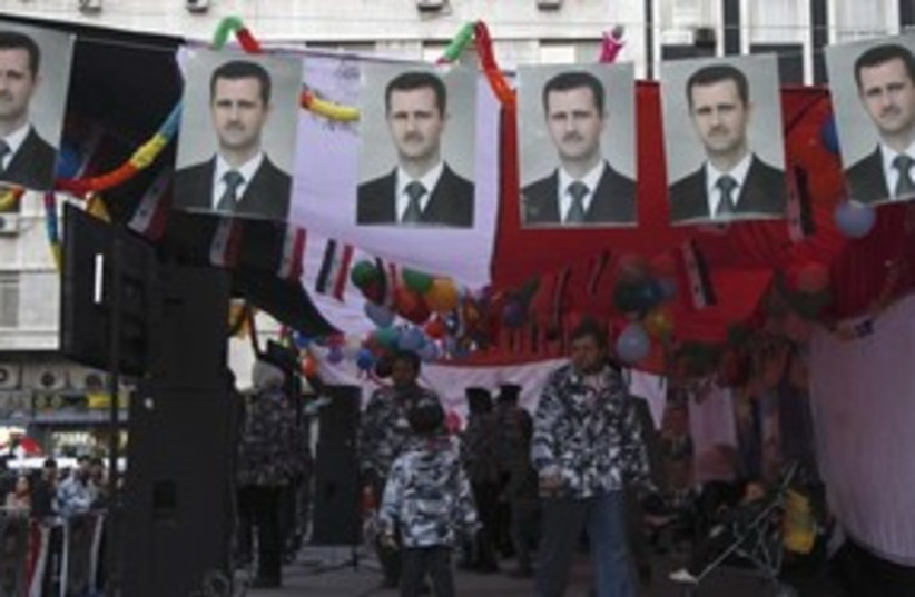 Assad flags, Damascus_311 (photo credit: Reuters)