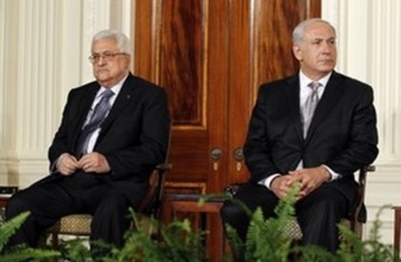 Prime Minister Netanyahu and PA President Abbas 390 (R) (photo credit: Jason Reed / Reuters)