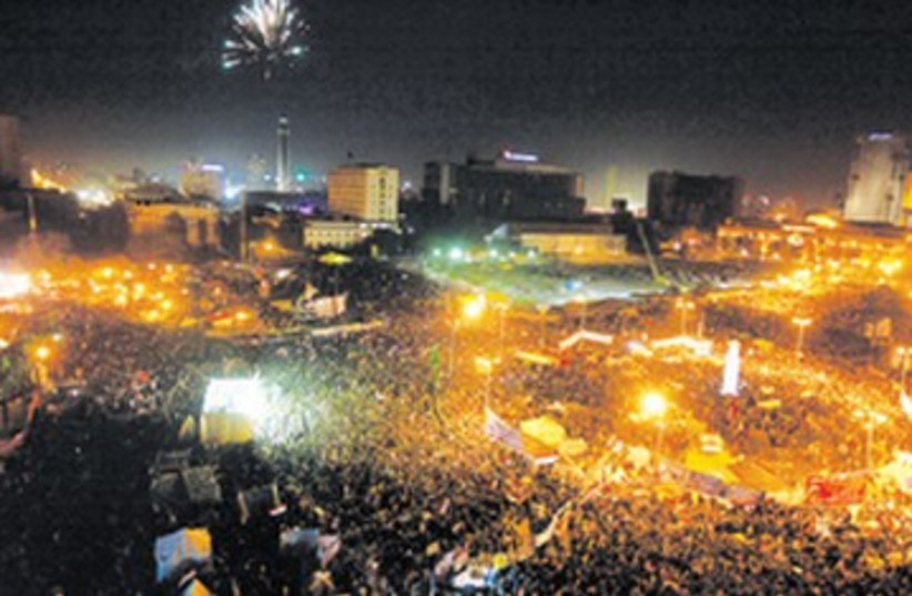 First anniversary of Egypt's uprising in Tahrir Square 390 (photo credit: Mohamed Abd El Ghany/Reuters))