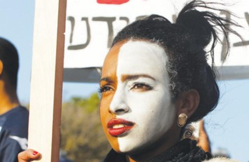 Protesting against discrimination in Jerusalem 390 (photo credit: Baz Ratner/Reuters)
