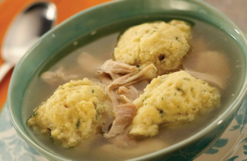 CHICKEN IN THE POT WITH MATZA BALLS (photo credit: Courtesy/MCT)