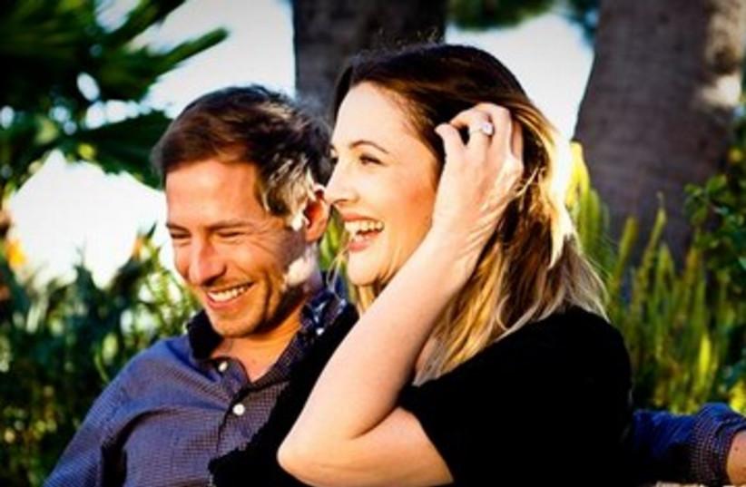 Drew Barrymore with fiancé Will Kopelman 390 (photo credit: REUTERS/Flower Films/Handout)