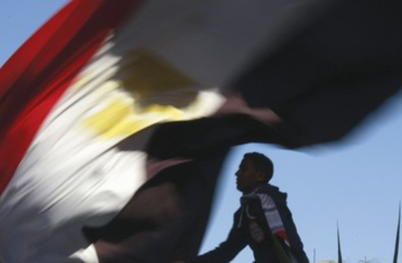 First anniversary of Egypt's uprising in Tahrir Square 390 (photo credit: REUTERS)