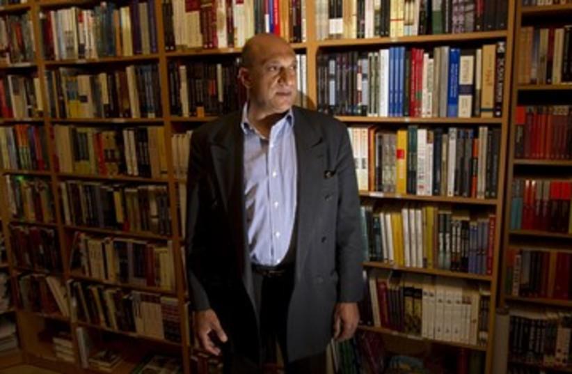 Palestinian book shop owner Munther Fahmi 390 (photo credit: Ronen Zvulun / Reuters)