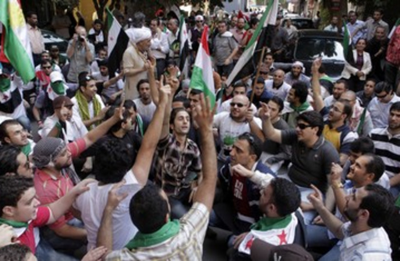 Anti-Assad Syrian protesters outside Cairo embassy 390 R (photo credit: REUTERS)
