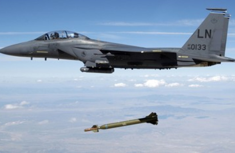 "US Air Force F-15E releases a GBU-28 ""Bunker Buster"" 390 (photo credit: REUTERS/Handout)"