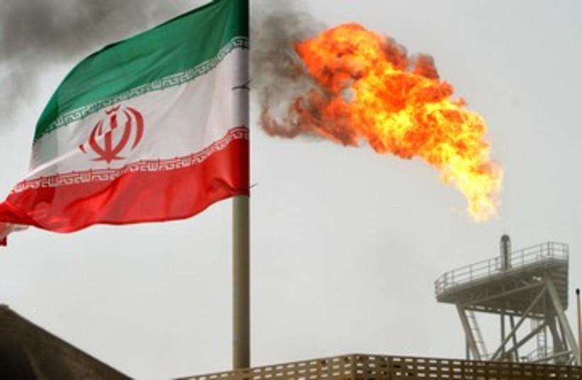Iranian oil platform, Iran flag (photo credit: Reuters)