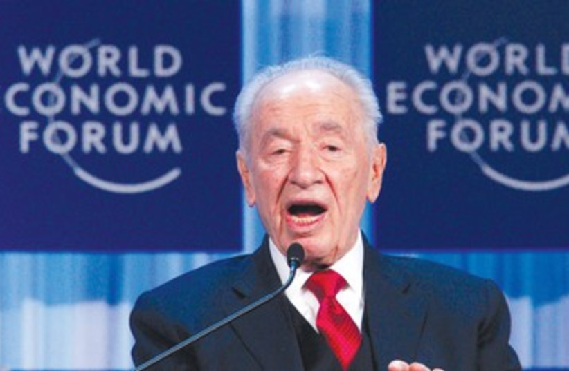 President Shimon Peres speaks in Davos (photo credit: REUTERS)