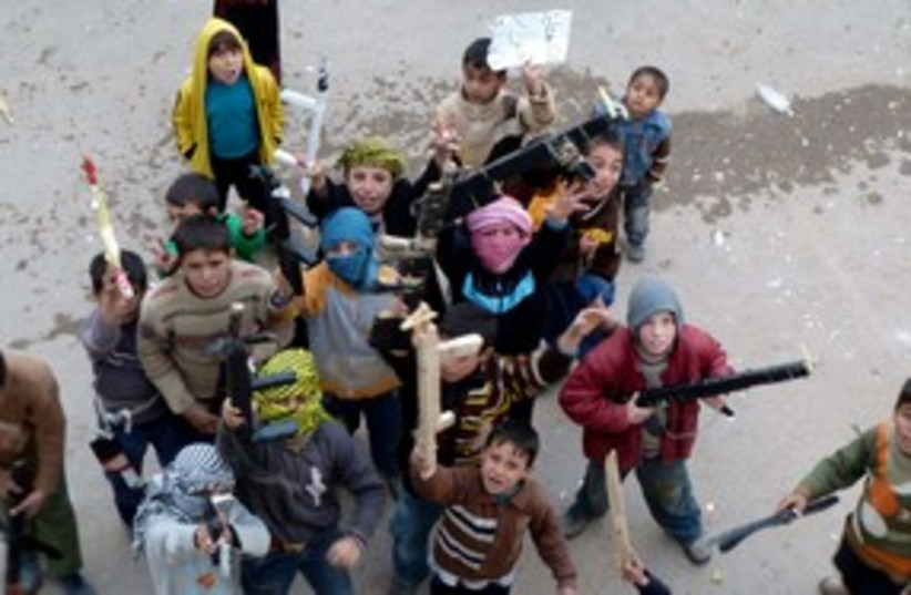 Chldren toy guns protest Syria 311 (photo credit: REUTERS)