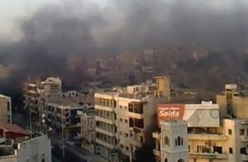 Smoke rising in Hama, Syria 390 (photo credit: REUTERS)