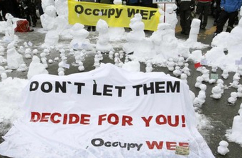 Protesters at WEF (photo credit: REUTERS/Arnd Wiegmann )