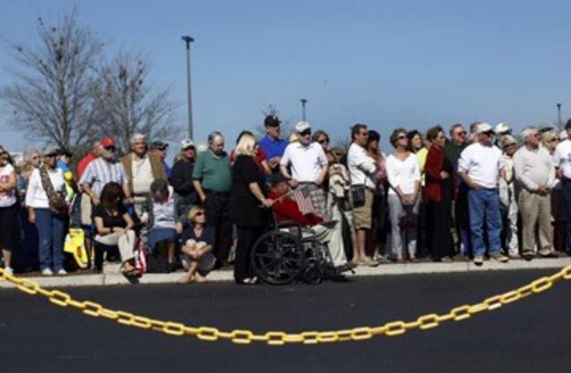 Republicans wait for Gingrich at rally in Florida_311 (photo credit: Reuters)