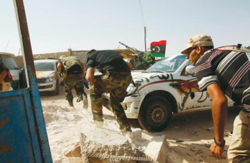 Libyan rebels 390 (photo credit: REUTERS)