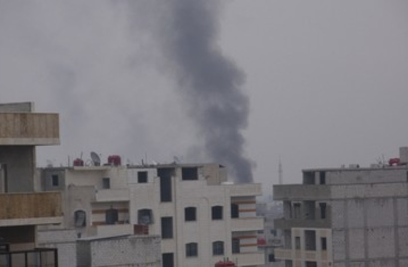 Smoke rising from suburb in Damascus 390 (photo credit: REUTERS)