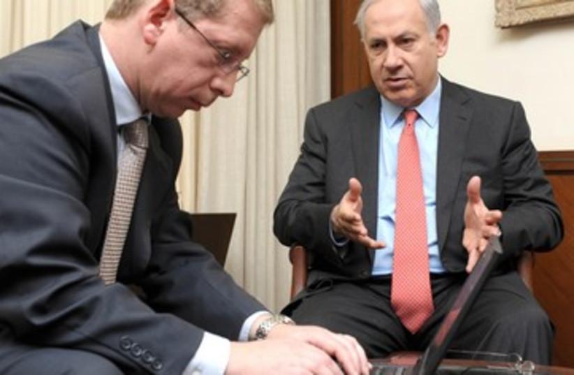 Prime Minister Binyamin Netanyahu with computer 390 (photo credit: Moshe Milner/GPO))