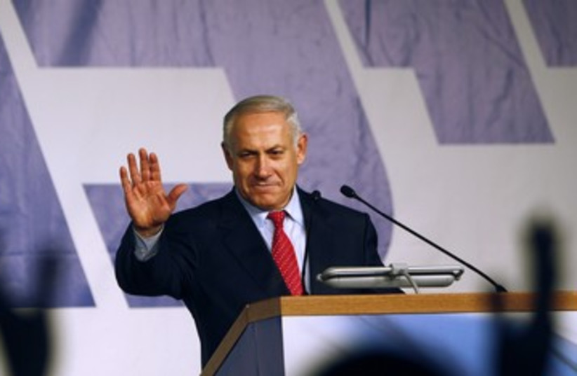 Netanyahu with likud background 390 (photo credit: REUTERS)
