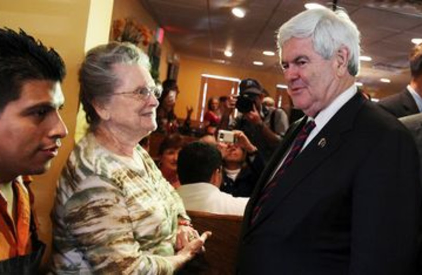 Republican Newt Gingrich greets voters in Florida 390 (R) (photo credit: REUTERS/Shannon Stapleton)