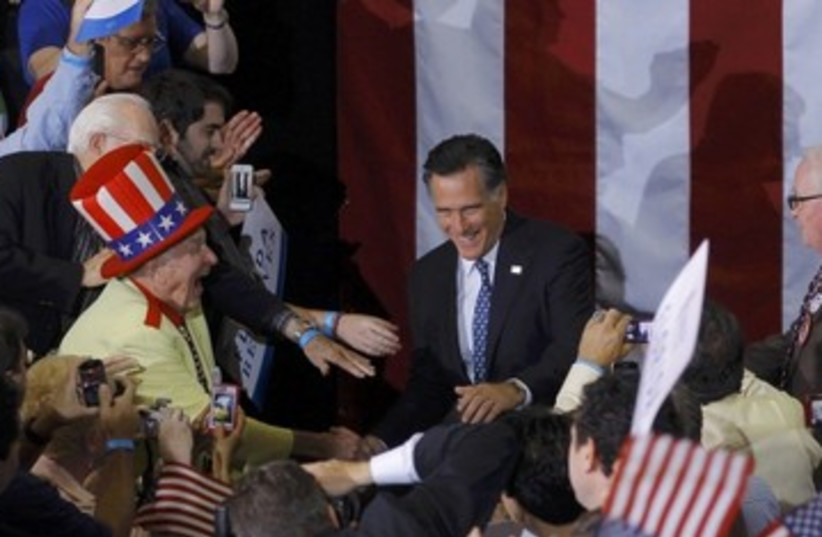 Romney with Florida supporters_390 (photo credit: Reuters)