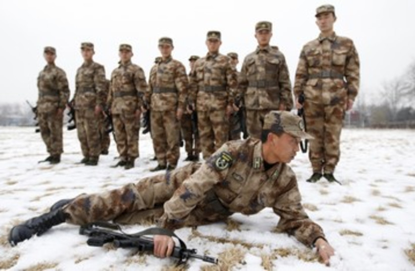 Chinese PLA army soldiers in training 390 (photo credit:  REUTERS/China Daily China Daily Information Corp)