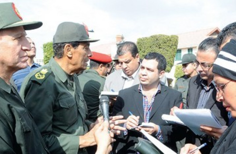 Tantawi with journalists 390 (photo credit: REUTERS)