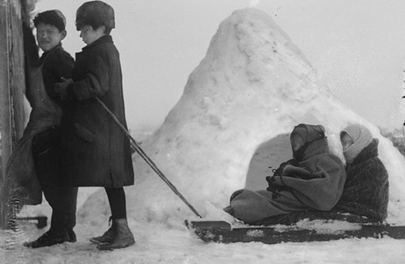 Children pulling sled in Jerusalem