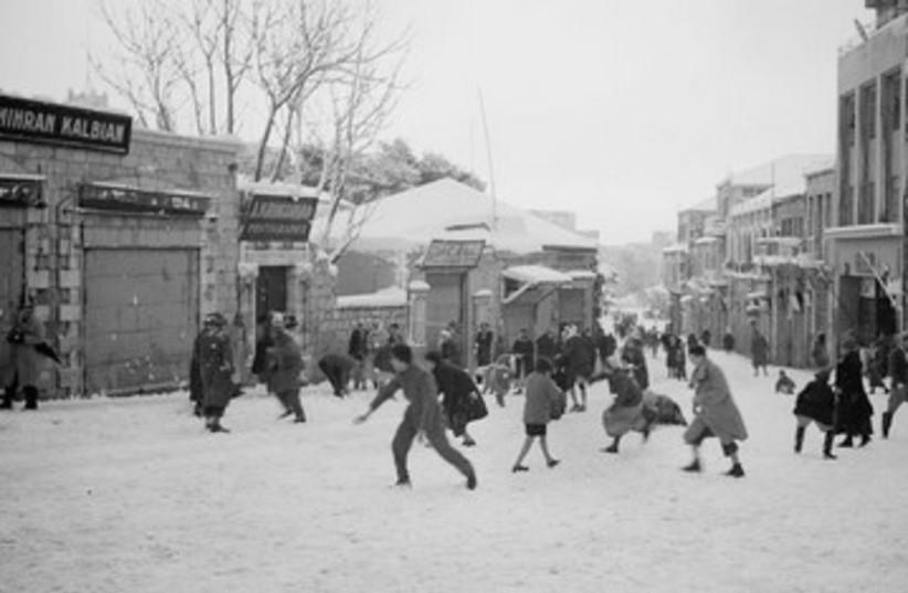 """Snowballing on Jaffa Road"" in Jerusalem 390 (photo credit: American Colony-Jerusalem-Photo Dept.)"