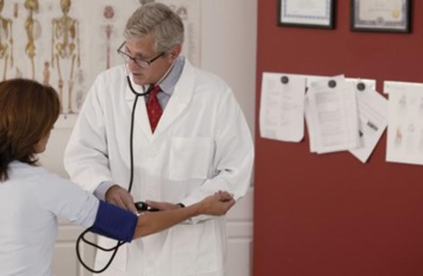 Male doctor, female patient (photo credit: Thinkstock/Imagebank)