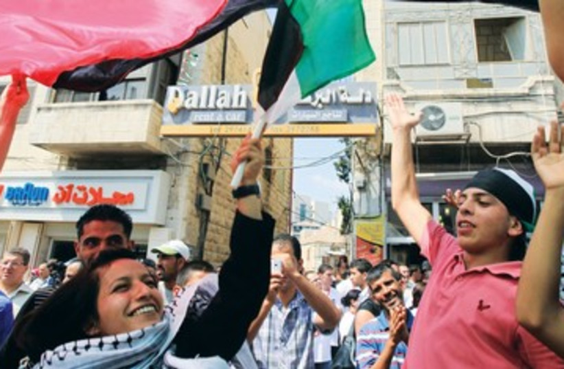 Palestinians celebrating fun joy 390 (photo credit: MARC ISRAEL SELLEM)