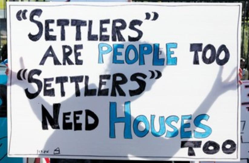 Settlers protest sign_390 (photo credit: Marc Israel Sellem/The Jerusalem Post)