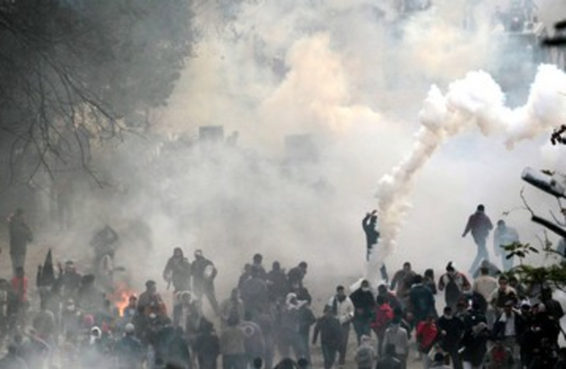 Protesters clash with riot police in Cairo Egypt 390 (R) (photo credit: REUTERS/Mohamed Abd El-Ghany)