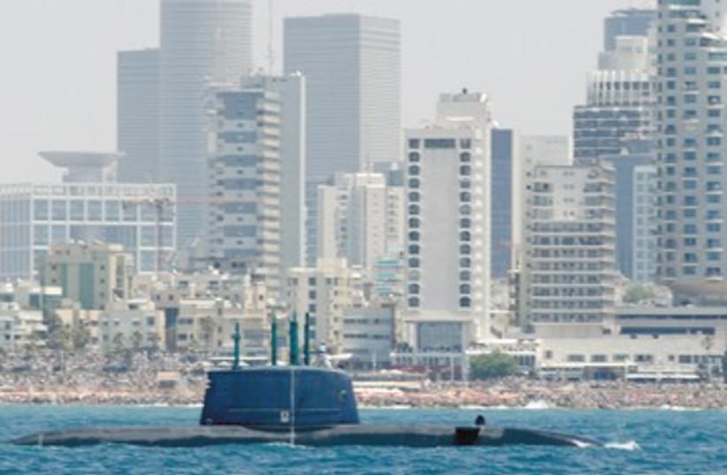 Israel Navy submarine sails off Tel Aviv 390 (photo credit: Baz Ratner/Reuters)