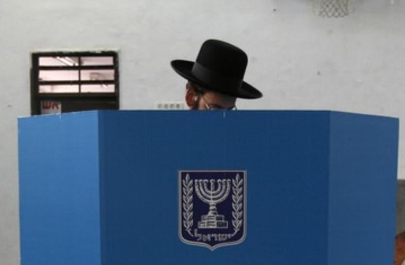 Haredi man casts ballot elections 390 (R) (photo credit: Gil Cohen Magen / Reuters)