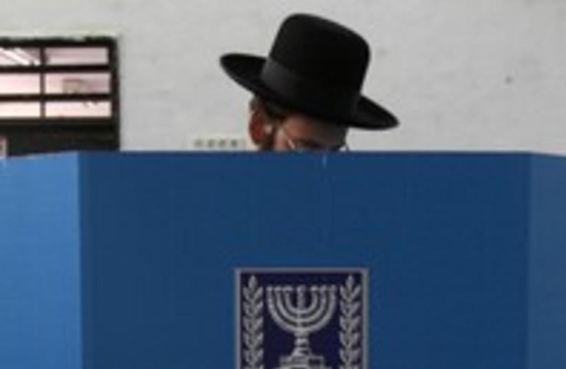 Haredi man casts ballot elections 300 (R) (photo credit: Gil Cohen Magen / Reuters)