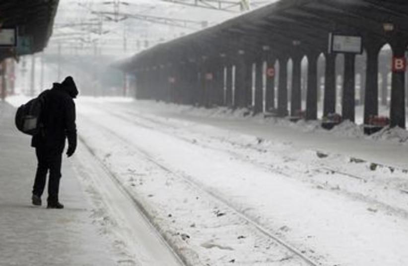 Man walks through empty rail station in Bucharest 390 (R) (photo credit: REUTERS/Bogdan Cristel)