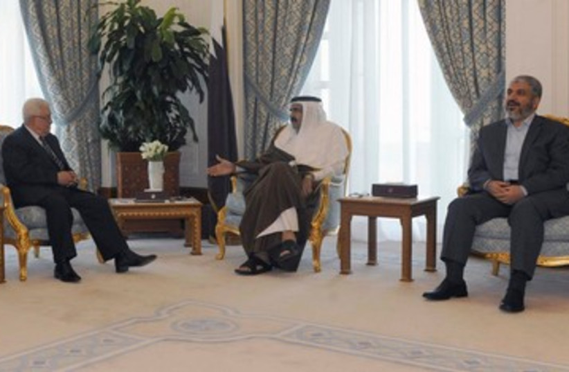 PA President Abbas meets Hamas chief Mashaal in Qatar 390 R (photo credit: REUTERS/Thaer Ghanaim/PPO/Handout)