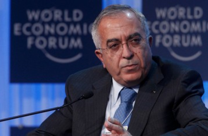 Palestinian Authority PM Salam Fayyad 390 (R) (photo credit: REUTERS/Christian Hartmann)
