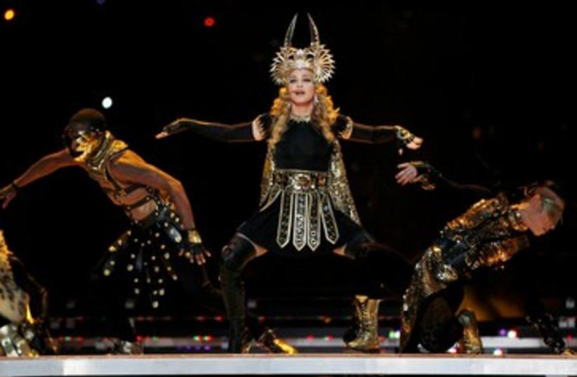 Madonna at superbowl 390 (photo credit: REUTERS/JEFF HAYNES)