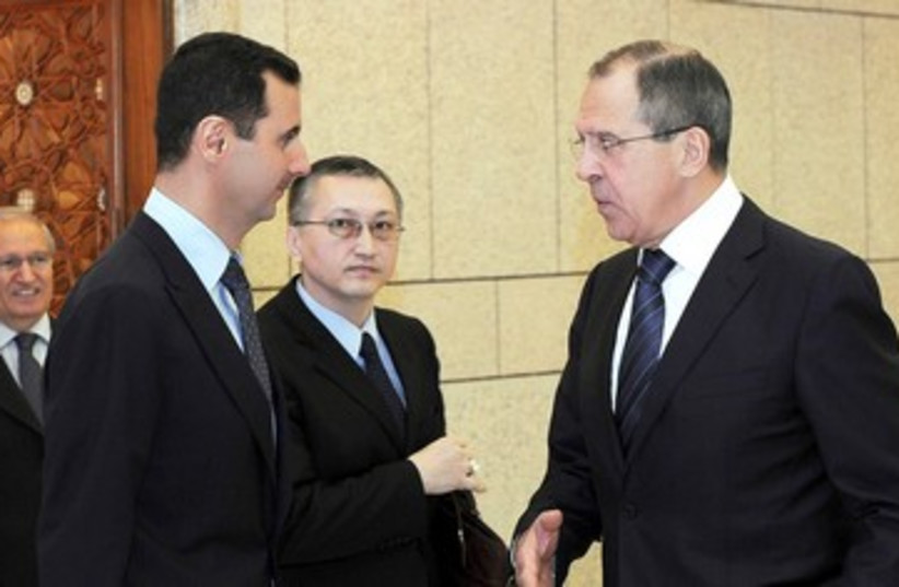 Assad and Lavrov 390 (photo credit: REUTERS)