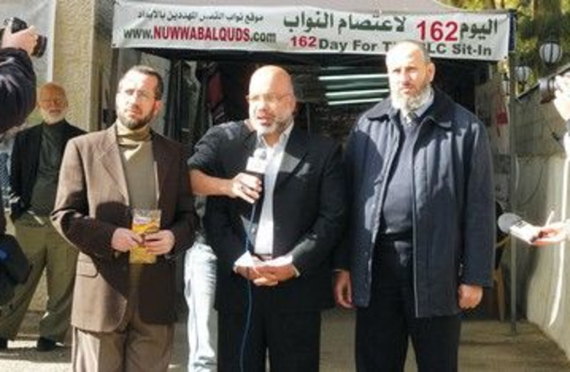 The Hamas members in front of J'lem Red Cross compound 390 (photo credit: Melanie Lidman)