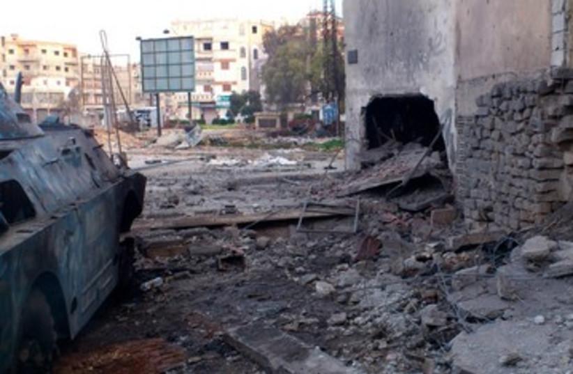 Homs after bombardment 390 (photo credit: REUTERS)